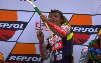 17 Aug 1997:  Valentino Rossi of Italy celebrates victory at the British Motorcycle Grand Prix at Donington Park in England. Rossi went on to win the 125cc world title.  \ Mandatory Credit: Mike Cooper /Allsport