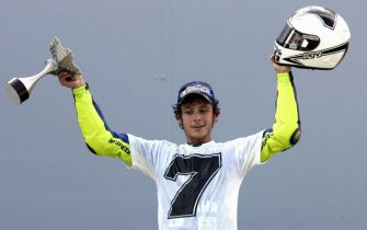 SEPANG, MALAYSIA:  Italian rider Valentino Rossi of Yamaha jubilates at the prize presentation during the Malaysian Grand Prix in Sepang International Circuit 25 September 2005. Rossi claimed his seventh world championship title when he finished second in the Malaysian MotoGP. AFP PHOTO/ ROSLAN RAHMAN  (Photo credit should read ROSLAN RAHMAN/AFP via Getty Images)