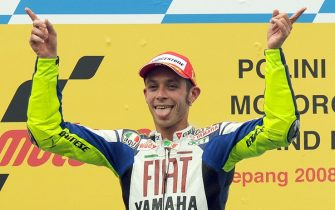 Italian rider Valentino Rossi of Fiat Yamaha Team gestures on the podium after winning the Malaysian MotoGP on October 19, 2008 in Sepang. Newly crowned world champion Valentino Rossi won the Malaysian MotoGP on his Yamaha, with Dani Pedrosa riding a Honda finishing a distant second.   AFP PHOTO/ROSLAN RAHMAN (Photo credit should read ROSLAN RAHMAN/AFP/Getty Images)