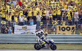 MotoGP world champion Valentino Rossi of Italy celebrates his 100th grand prix victory at the Dutch TT race at Assen, on June 27, 2009. Rossi won the Dutch MotoGp to record his 100th career win and take the overall lead in the world championship standings. The eight-time world champion beat home his Yamaha team-mate Jorge Lorenzo while Australia's 2007 world champion Casey Stoner was third on a Ducati. AFP PHOTO/ANP/VINCENT JANNINK   ---netherlands out - belgium out--- (Photo credit should read VINCENT JANNINK/AFP/Getty Images)
