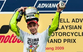 KUALA LUMPUR, MALAYSIA - OCTOBER 25:  Fiat Yamaha Team rider Valentino Rossi of Italy celebrates on the podium after winning his ninth MotoGP World Championship title with his third place in the Malaysian MotoGP, which is round 16 of the MotoGP World Championship at the Sepang Circuit on October 25, 2009 in Kuala Lumpur, Malaysia.  (Photo by Victor Fraile/Getty Images)