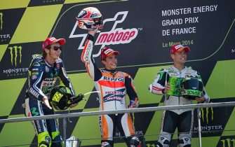LE MANS, FRANCE - MAY 18: (L-R) Valentino Rossi of Italy and Movistar Yamaha MotoGP , Marc Marquez of Spain and Repsol Honda Team and Alvaro Bautista of Spain and Go&Fun Honda Gresini  celebrate on the podium at the end of the MotoGP race during the MotoGp Of France - Race on May 18, 2014 in Le Mans, France.  (Photo by Mirco Lazzari gp/Getty Images)