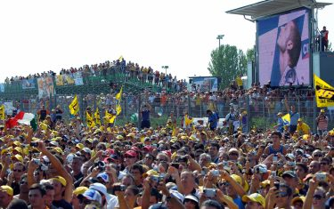 Fiat Yamaha rider Italy's Valentino Rossi fans celebrate his victory in the Moto GP race at Misano track during the San Marino Grand Prix in Misano Adriatico on August 31, 2008. Seven-time world champion Valentino Rossi won the San Marino Grand Prix here on Sunday ahead of teammate Jorge Lorenzo and Spaniard Toni Elias. The victory allowed the Italian to equal compatriot Giacomo Agostini's record of 68 victories in the top Moto GP category.             AFP PHOTO / Vincenzo Pinto (Photo credit should read VINCENZO PINTO/AFP via Getty Images)