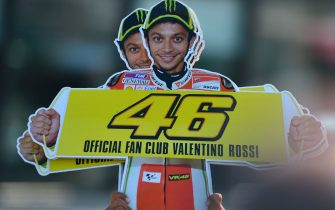A supporter holds a placard showing Italian rider Valentino Rossi of the Ducati team after the San Marino MotoGP Grand Prix on September 16 , 2012 at the Misano world circuit in Missano Adriatico. Spanish rider Jorge Lorenzo won ahead of Italians Valentino Rossi and Alvaro Bautista.  AFP PHOTO / GABRIEL BOUYS        (Photo credit should read GABRIEL BOUYS/AFP/GettyImages)
