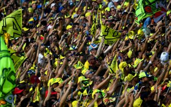 Movistar Yamaha MotoGP's Italian rider Valentino Rossi fans cheer near the podium of the San Marino Moto GP Grand Prix race at the Marco Simoncelli Circuit in Misano, on September 11, 2016.  / AFP / GABRIEL BOUYS        (Photo credit should read GABRIEL BOUYS/AFP via Getty Images)