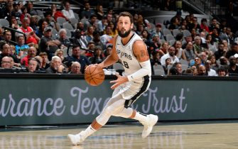SAN ANTONIO, TX - OCTOBER 13: Marco Belinelli #18 of the San Antonio Spurs handles the ball against the New Orleans Pelicans during a pre-season game on October 13, 2019 at the AT&T Center in San Antonio, Texas. NOTE TO USER: User expressly acknowledges and agrees that, by downloading and or using this photograph, user is consenting to the terms and conditions of the Getty Images License Agreement. Mandatory Copyright Notice: Copyright 2019 NBAE (Photos by Logan Riely/NBAE via Getty Images)