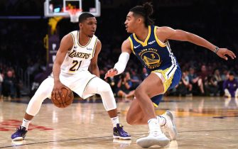 LOS ANGELES, CALIFORNIA - OCTOBER 14:  Zach Norvell Jr. #21 of the Los Angeles Lakers crosses over on Jordan Poole #3 of the Golden State Warriors during a 104-98 Lakers preseason win at Staples Center on October 14, 2019 in Los Angeles, California. (Photo by Harry How/Getty Images)