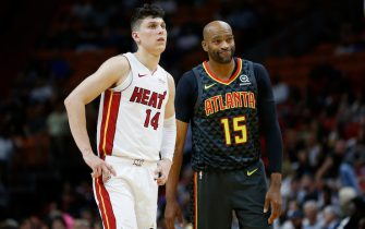 MIAMI, FLORIDA - OCTOBER 14:  Tyler Herro #14 of the Miami Heat looks on against Vince Carter #15 of the Atlanta Hawks during the second half of the preseason game at American Airlines Arena on October 14, 2019 in Miami, Florida. NOTE TO USER: User expressly acknowledges and agrees that, by downloading and or using this photograph, User is consenting to the terms and conditions of the Getty Images License Agreement.  (Photo by Michael Reaves/Getty Images)