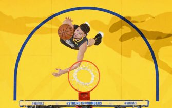 OAKLAND, CA - JUNE 13: Klay Thompson #11 of the Golden State Warriors rebounds the ball against the Toronto Raptors during Game Six of the 2019 NBA Finals on June 13, 2019 at ORACLE Arena in Oakland, California. NOTE TO USER: User expressly acknowledges and agrees that, by downloading and/or using this photograph, user is consenting to the terms and conditions of Getty Images License Agreement. Mandatory Copyright Notice: Copyright 2019 NBAE (Photo by Nathaniel S. Butler/NBAE via Getty Images)