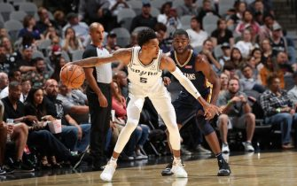 SAN ANTONIO, TX - OCTOBER 13: Dejounte Murray #5 of the San Antonio Spurs handles the ball against the New Orleans Pelicans during a pre-season game on October 13, 2019 at the AT&T Center in San Antonio, Texas. NOTE TO USER: User expressly acknowledges and agrees that, by downloading and or using this photograph, user is consenting to the terms and conditions of the Getty Images License Agreement. Mandatory Copyright Notice: Copyright 2019 NBAE (Photos by Joe Murphy/NBAE via Getty Images)