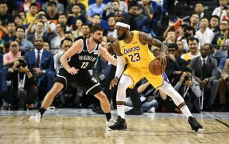 SHANGHAI, CHINA - OCTOBER 10: LeBron James #23 of the Los Angeles Lakers handles the ball against Joe Harris #12 of the Brooklyn Nets during a preseason game as part of 2019 NBA Global Games China at Mercedes-Benz Arena on October 10, 2019 in Shanghai, China. NOTE TO USER: User expressly acknowledges and agrees that, by downloading and/or using this photograph, user is consenting to the terms and conditions of the Getty Images License Agreement. (Photo by Yanshan Zhang/Getty Images)