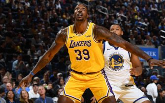 LOS ANGELES, CA - OCTOBER 5: Dwight Howard #39 of the Los Angeles Lakers boxes out to grab the rebound against the Golden State Warriors during the preseason on October 5, 2019 at Oakland Arena in San Francisco, California. NOTE TO USER: User expressly acknowledges and agrees that, by downloading and/or using this Photograph, user is consenting to the terms and conditions of the Getty Images License Agreement. Mandatory Copyright Notice: Copyright 2019 NBAE (Photo by Andrew D. Bernstein/NBAE via Getty Images)