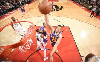 TORONTO, CANADA - JANUARY 1:  Dante Exum #11 of the Utah Jazz dunks the ball against the Toronto Raptors on January 1, 2019 at the Scotiabank Arena in Toronto, Ontario, Canada.  NOTE TO USER: User expressly acknowledges and agrees that, by downloading and or using this Photograph, user is consenting to the terms and conditions of the Getty Images License Agreement.  Mandatory Copyright Notice: Copyright 2019 NBAE (Photo by Ron Turenne/NBAE via Getty Images)