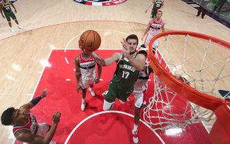WASHINGTON, DC - OCTOBER 13: Dragan Bender #17 of the Milwaukee Bucks shoots the ball against the Washington Wizards during a pre-season game on October 13, 2019 at Capital One Arena in Washington, DC. NOTE TO USER: User expressly acknowledges and agrees that, by downloading and or using this Photograph, user is consenting to the terms and conditions of the Getty Images License Agreement. Mandatory Copyright Notice: Copyright 2019 NBAE (Photo by Ned Dishman/NBAE via Getty Images)