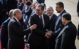 Serbian President Aleksandar Vucic (C) shakes hands with former NBA basketball player Hidayet Turkoglu (R) as he speaks with his Turkish counterpart Recep Tayyip Erdogan (L) prior to their meeting in Belgrade on October 7, 2019. (Photo by OLIVER BUNIC / AFP) (Photo by OLIVER BUNIC/AFP via Getty Images)