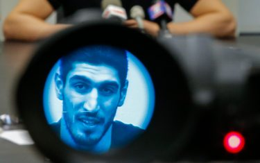 NEW YORK, NY - MAY 22:  Turkish NBA Player Enes Kanter, seen through a video camera, speaks to the media during a news conference about his detention at a Romanian airport on May 22, 2017 in New York City. Kanter returned to the U.S. after being detained for several hours at a Romanian airport following statements he made criticizing Turkey's president Recep Tayyip Erdogan. (Photo by Eduardo Munoz Alvarez/Getty Images)