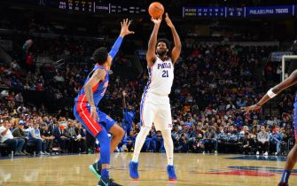 PHILADELPHIA, PA - OCTOBER 15: Joel Embiid #21 of the Philadelphia 76ers shoots a three-pointer against the Detroit Pistons during a pre-season game on October 15, 2019 at the Wells Fargo Center in Philadelphia, Pennsylvania NOTE TO USER: User expressly acknowledges and agrees that, by downloading and/or using this Photograph, user is consenting to the terms and conditions of the Getty Images License Agreement. Mandatory Copyright Notice: Copyright 2019 NBAE (Photo by Jesse D. Garrabrant/NBAE via Getty Images)