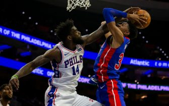 PHILADELPHIA, PA - OCTOBER 15: Norvel Pelle #14 of the Philadelphia 76ers blocks the shot of Christian Wood #35 of the Detroit Pistons in the fourth quarter of the preseason game at the Wells Fargo Center on October 15, 2019 in Philadelphia, Pennsylvania. The 76ers defeated the Pistons 106-86. NOTE TO USER: User expressly acknowledges and agrees that, by downloading and or using this photograph, User is consenting to the terms and conditions of the Getty Images License Agreement. (Photo by Mitchell Leff/Getty Images)