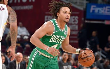 CLEVELAND, OH - OCTOBER 15: Carsen Edwards #4 of the Boston Celtics handles the ball against the Cleveland Cavaliers during a pre-season game on October 15, 2019 at Quicken Loans Arena in Cleveland, Ohio. NOTE TO USER: User expressly acknowledges and agrees that, by downloading and/or using this Photograph, user is consenting to the terms and conditions of the Getty Images License Agreement. Mandatory Copyright Notice: Copyright 2019 NBAE (Photo by David Liam Kyle/NBAE via Getty Images)