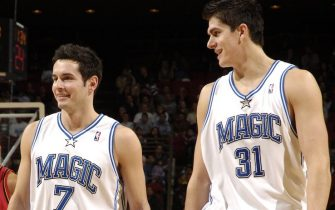 ORLANDO, FL - NOVEMBER 25:  J.J. Redick #7 of the Orlando Magic, along with teammate Darko Milicic #31, smiles after scoring his first 2 points as an NBA player on a jump shot against the Atlanta Hawks on November 25, 2006 at TD Waterhouse Centre in Orlando, Florida.  NOTE TO USER: User expressly acknowledges and agrees that, by downloading and/or using this Photograph, user is consenting to the terms and conditions of the Getty Images License Agreement. Mandatory Copyright Notice:  Copyright 2006 NBAE (Photo by Fernando Medina/NBAE via Getty Images)