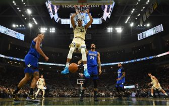 MILWAUKEE, WISCONSIN - DECEMBER 09:  Giannis Antetokounmpo #34 of the Milwaukee Bucks dunks against the Orlando Magic during a game at Fiserv Forum on December 09, 2019 in Milwaukee, Wisconsin. NOTE TO USER: User expressly acknowledges and agrees that, by downloading and or using this photograph, User is consenting to the terms and conditions of the Getty Images License Agreement. (Photo by Stacy Revere/Getty Images)