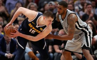 DENVER, COLORADO - APRIL 27: Nikola Jokic #15 of the Denver Nuggets is guraded by Lamarcus Aldridge #12 of the San Antonio Spurs in the fourth quarter during Game Seven of the first round of the 2019 NBA Western Conference Playoffs at the Pepsi Center on April 27, 2019 in Denver, Colorado. NOTE TO USER: User expressly acknowledges and agrees that, by downloading and or using this photograph, User is consenting to the terms and conditions of the Getty Images  (Photo by Matthew Stockman/Getty Images)