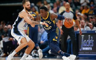 INDIANAPOLIS, IN - NOVEMBER 27: Victor Oladipo #4 of the Indiana Pacers dribbles the ball against Evan Fournier #10 of the Orlando Magic at Bankers Life Fieldhouse on November 27, 2017 in Indianapolis, Indiana. NOTE TO USER: User expressly acknowledges and agrees that, by downloading and or using this photograph, User is consenting to the terms and conditions of the Getty Images License Agreement.(Photo by Michael Hickey/Getty Images)