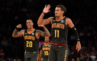 NEW YORK, NEW YORK - OCTOBER 16: Trae Young #11 and John Collins #20 of the Atlanta Hawks react during the second quarter of the preseason game against the New York Knicks at Madison Square Garden on October 16, 2019 in New York City. NOTE TO USER: User expressly acknowledges and agrees that, by downloading and or using this Photograph, user is consenting to the terms and conditions of the Getty Images License Agreement. Mandatory Copyright Notice: Copyright 2019 NBAE (Photo by Sarah Stier/Getty Images)