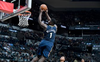SAN ANTONIO, TX - OCTOBER 13: Zion Williamson #1 of the New Orleans Pelicans dunks the ball against the San Antonio Spurs during a pre-season game on October 13, 2019 at the AT&T Center in San Antonio, Texas. NOTE TO USER: User expressly acknowledges and agrees that, by downloading and or using this photograph, user is consenting to the terms and conditions of the Getty Images License Agreement. Mandatory Copyright Notice: Copyright 2019 NBAE (Photos by Logan Riely/NBAE via Getty Images)