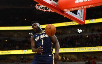 CHICAGO, ILLINOIS - OCTOBER 09:  Zion Williamson #1 of the New Orleans Pelicans dunks against the Chicago Bulls during the first half of a preseason game at the United Center on October 09, 2019 in Chicago, Illinois. NOTE TO USER: User expressly acknowledges and agrees that, by downloading and or using this photograph, User is consenting to the terms and conditions of the Getty Images License Agreement. (Photo by Stacy Revere/Getty Images)