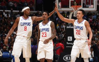 LOS ANGELES, CA - OCTOBER 10: Maurice Harkless #8 of the LA Clippers high-fives Landry Shamet #20 of the LA Clippers against the Denver Nuggets during the preseaspn on October 10, 2019 at STAPLES Center in Los Angeles, California. NOTE TO USER: User expressly acknowledges and agrees that, by downloading and/or using this Photograph, user is consenting to the terms and conditions of the Getty Images License Agreement. Mandatory Copyright Notice: Copyright 2019 NBAE (Photo by Adam Pantozzi/NBAE via Getty Images)