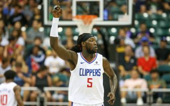 HONOLULU, HI - OCTOBER 06: Montrezl Harrell #5 of the Los Angeles Clippers gestures to the crowd after making a basket during the first half of the game against the Shanghai Sharks at the Stan Sheriff Center on October 6, 2019 in Honolulu, Hawaii. TO USER: User expressly acknowledges and agrees that, by downloading and/or using this photograph, user is consenting to the terms and conditions of the Getty Images License Agreement. (Photo by Darryl Oumi/Getty Images)