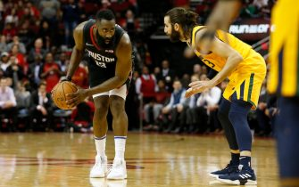 HOUSTON, TX - DECEMBER 17:  James Harden #13 of the Houston Rockets controls the ball defended by Ricky Rubio #3 of the Utah Jazz in the second half at Toyota Center on December 17, 2018 in Houston, Texas.  NOTE TO USER: User expressly acknowledges and agrees that, by downloading and or using this photograph, User is consenting to the terms and conditions of the Getty Images License Agreement.  (Photo by Tim Warner/Getty Images)