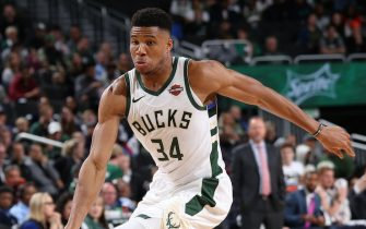 MILWAUKEE, WI - OCTOBER 17: Giannis Antetokounmpo #34 of the Milwaukee Bucks handles the ball during a pre-season game against the Minnesota Timberwolves on October 17, 2019 at the Fiserv Forum Center in Milwaukee, Wisconsin. NOTE TO USER: User expressly acknowledges and agrees that, by downloading and or using this Photograph, user is consenting to the terms and conditions of the Getty Images License Agreement. Mandatory Copyright Notice: Copyright 2019 NBAE (Photo by Gary Dineen/NBAE via Getty Images).