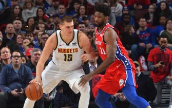 PHILADELPHIA, PA - FEBRUARY 8: Joel Embiid #21 of the Philadelphia 76ers plays defense against the Nikola Jokic #15 of the Denver Nuggets on February 8, 2019 at the Wells Fargo Center in Philadelphia, Pennsylvania. NOTE TO USER: User expressly acknowledges and agrees that, by downloading and/or using this photograph, user is consenting to the terms and conditions of the Getty Images License Agreement. Mandatory Copyright Notice: Copyright 2019 NBAE (Photo by Jesse D. Garrabrant/NBAE via Getty Images)