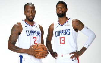 PLAYA VISTA, CA - SEPTEMBER 29: Kawhi Leonard #2 and Paul George #13 of the LA Clippers pose for a portrait during media day on September 29, 2019 at the Honey Training Center: Home of the LA Clippers in Playa Vista, California. NOTE TO USER: User expressly acknowledges and agrees that, by downloading and/or using this photograph, user is consenting to the terms and conditions of the Getty Images License Agreement. Mandatory Copyright Notice: Copyright 2019 NBAE (Photo by Andrew D. Bernstein/NBAE via Getty Images)