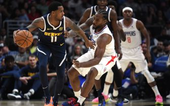 LOS ANGELES, CALIFORNIA - OCTOBER 10:  Monte Morris #11 of the Denver Nuggets fends off a steal by Kawhi Leonard #2 of the LA Clippers during the first half at Staples Center on October 10, 2019 in Los Angeles, California. (Photo by Harry How/Getty Images)