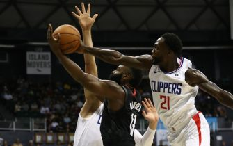 HONOLULU, HI - OCTOBER 03: James Harden #13 of the Houston Rockets has his shot swatted away by Patrick Beverley #21 of the Los Angeles Clippers during the first half of their game at the Stan Sheriff Center on October 3, 2019 in Honolulu, Hawaii. TO USER: User expressly acknowledges and agrees that, by downloading and/or using this photograph, user is consenting to the terms and conditions of the Getty Images License Agreement. (Photo by Darryl Oumi/Getty Images)