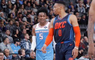 SACRAMENTO, CA - DECEMBER 19: De'Aaron Fox #5 of the Sacramento Kings talks to Russell Westbrook #0 of the Oklahoma City Thunder on December 19, 2018 at Golden 1 Center in Sacramento, California. NOTE TO USER: User expressly acknowledges and agrees that, by downloading and or using this photograph, User is consenting to the terms and conditions of the Getty Images Agreement. Mandatory Copyright Notice: Copyright 2018 NBAE (Photo by Rocky Widner/NBAE via Getty Images)