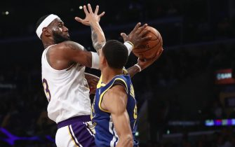 LOS ANGELES, CALIFORNIA - OCTOBER 16:  Juan Toscano-Anderson #95 of the Golden State Warriors defends against LeBron James #23 of the Los Angeles Lakers during the second half of a game at Staples Center on October 16, 2019 in Los Angeles, California. (Photo by Sean M. Haffey/Getty Images)