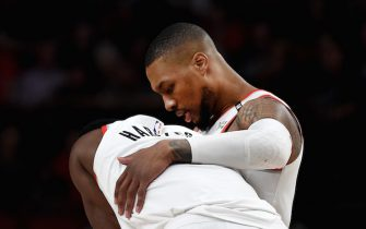 PORTLAND, OREGON - MAY 09: Damian Lillard #0 speaks with Maurice Harkless #4 of the Portland Trail Blazers during the second half of Game Six of the Western Conference Semifinals against the Denver Nuggets at Moda Center on May 09, 2019 in Portland, Oregon. The Blazers won 119-108. NOTE TO USER: User expressly acknowledges and agrees that, by downloading and or using this photograph, User is consenting to the terms and conditions of the Getty Images License Agreement. (Photo by Steve Dykes/Getty Images)