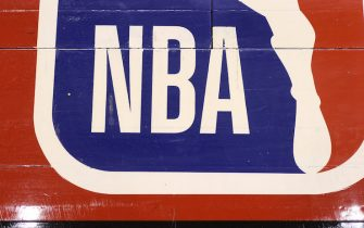 TORONTO, ON - OCTOBER 26: A detailed view of the NBA logo painted on the wooden floor boards of the court prior to the start of the Toronto Raptors NBA game against the Dallas Mavericks at Scotiabank Arena on October 26, 2018 in Toronto, Canada. NOTE TO USER: User expressly acknowledges and agrees that, by downloading and or using this photograph, User is consenting to the terms and conditions of the Getty Images License Agreement. (Photo by Tom Szczerbowski/Getty Images) *** Local Caption ***
