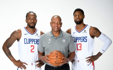 PLAYA VISTA, CA - SEPTEMBER 29: Kawhi Leonard #2, Head Coach Doc Rivers, and Paul George #13 of the LA Clippers pose for a portrait during media day on September 29, 2019 at the Honey Training Center: Home of the LA Clippers in Playa Vista, California. NOTE TO USER: User expressly acknowledges and agrees that, by downloading and/or using this photograph, user is consenting to the terms and conditions of the Getty Images License Agreement. Mandatory Copyright Notice: Copyright 2019 NBAE (Photo by Andrew D. Bernstein/NBAE via Getty Images)