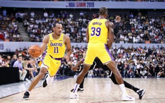 SHENZHEN, CHINA - OCTOBER 12: Avery Bradley #11 and Dwight Howard #39 of the Los Angeles Lakers in action during the match against the Brooklyn Nets during a preseason game as part of 2019 NBA Global Games China at Shenzhen Universiade Center on October 12, 2019 in Shenzhen, Guangdong, China. (Photo by Zhong Zhi/Getty Images)