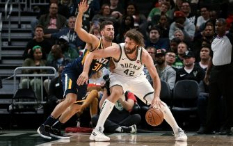 MILWAUKEE, WISCONSIN - OCTOBER 09:  Robin Lopez #42 of the Milwaukee Bucks dribbles the ball while being guarded by Georges Niang #31 of the Utah Jazz in the first quarter during a preseason game at Fiserv Forum on October 09, 2019 in Milwaukee, Wisconsin. NOTE TO USER: User expressly acknowledges and agrees that, by downloading and or using this photograph, User is consenting to the terms and conditions of the Getty Images License Agreement. (Photo by Dylan Buell/Getty Images)