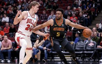 CHICAGO, ILLINOIS - OCTOBER 17:  Jabari Parker #5 of the Atlanta Hawks dribbles the ball while being guarded by Lauri Markkanen #24 of the Chicago Bulls in the first quarter during a preseason game at the United Center on October 17, 2019 in Chicago, Illinois. NOTE TO USER: User expressly acknowledges and agrees that, by downloading and/or using this photograph, user is consenting to the terms and conditions of the Getty Images License Agreement. (Photo by Dylan Buell/Getty Images)