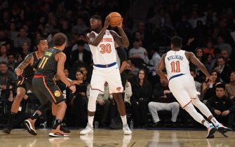 NEW YORK, NEW YORK - OCTOBER 16: Julius Randle #30 of the New York Knicks looks to pass against Trae Young #11 of the Atlanta Hawks during the first quarter of the preseason game at Madison Square Garden on October 16, 2019 in New York City. NOTE TO USER: User expressly acknowledges and agrees that, by downloading and or using this Photograph, user is consenting to the terms and conditions of the Getty Images License Agreement. Mandatory Copyright Notice: Copyright 2019 NBAE (Photo by Sarah Stier/Getty Images)