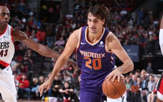 PORTLAND, OR - OCTOBER 12: Dario Saric #20 of the Phoenix Suns handles the ball against the Portland Trail Blazers during a pre-season game on October 12, 2019 at the Moda Center in Portland, Oregon. NOTE TO USER: User expressly acknowledges and agrees that, by downloading and or using this Photograph, user is consenting to the terms and conditions of the Getty Images License Agreement. Mandatory Copyright Notice: Copyright 2019 NBAE (Photo by Sam Forencich/NBAE via Getty Images)