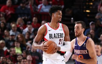PORTLAND, OR - OCTOBER 12: Hassan Whiteside #21 of the Portland Trail Blazers handles the ball against the Phoenix Suns during a pre-season game on October 12, 2019 at the Moda Center in Portland, Oregon. NOTE TO USER: User expressly acknowledges and agrees that, by downloading and or using this Photograph, user is consenting to the terms and conditions of the Getty Images License Agreement. Mandatory Copyright Notice: Copyright 2019 NBAE (Photo by Sam Forencich/NBAE via Getty Images)