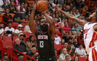 MIAMI, FL - OCTOBER 18: James Harden #13 of the Houston Rockets handles the ball against the Miami Heat during a pre-season game on October 18, 2019 at American Airlines Arena in Miami, Florida. NOTE TO USER: User expressly acknowledges and agrees that, by downloading and or using this Photograph, user is consenting to the terms and conditions of the Getty Images License Agreement. Mandatory Copyright Notice: Copyright 2019 NBAE (Photo by Issac Baldizon/NBAE via Getty Images)